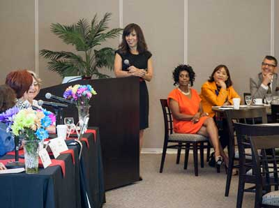 TIPS coordinator Jo‑Ann Cuevas moderates a panel reviewing 25 years of TIPS group contributions