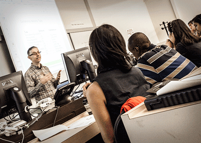 An instructor interacts with attendees in a Techie Fest lecture class on project management.