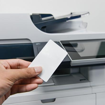 Image of person using badge to print