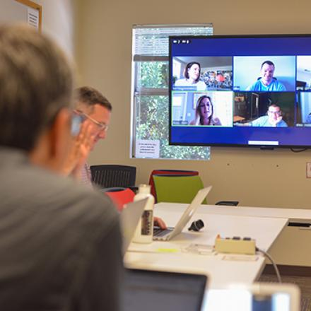 Image of people in video conferencing room