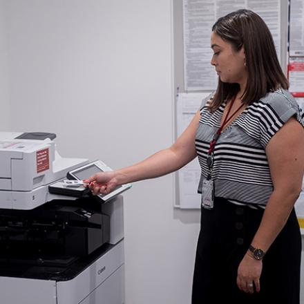 Image of staff member using a Cardinal Print device