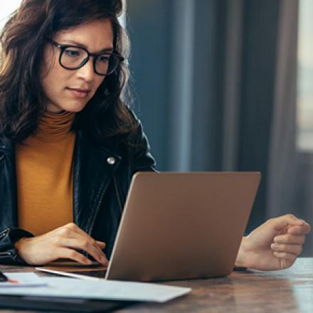 Image of woman in front of laptop