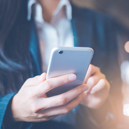 Image of woman using iPhone