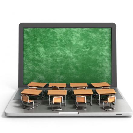 Image of desks and laptop