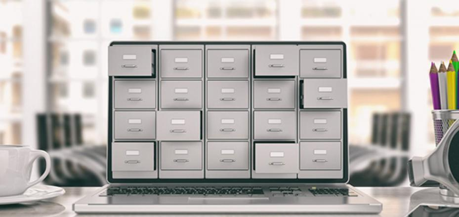 Image of laptop with file cabinet drawers on it